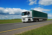 White lorry with green trailer — Stock Photo