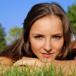 Girl outdoors lying on the grass — Stock Photo #1050902