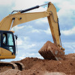 Foto Stock: Excavator bulldozer loader in sandpit