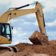 Excavator bulldozer loader in sandpit — Stock Photo