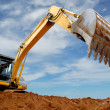 Excavator loader in sandpit - Stock Photo