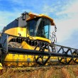 Harvesting combine in the field — Stock Photo