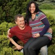 Young happy couple (pregnant woman) on t — Stock Photo