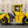 Yellow Asphalt Paving Machine - Stock Photo