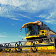 Harvesting combine in the field - Foto Stock