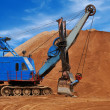 Heavy electric excavator in sandpit - Stock Photo