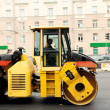 Asphalting road roller compactor - Stock Photo