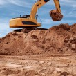 Excavator bulldozer in sandpit — Stock Photo #1051216