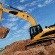 Stock Photo: Excavator in sandpit