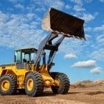 Wheel loader bulldozer in sandpit — Stock Photo