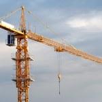 Single yellow tower crane — Stock Photo