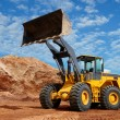 Wheel loader bulldozer in sandpit - Stock Photo