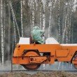 Orange road roller - Stock Photo