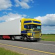 Single truck with blue-yellow cabin movi — Stock Photo