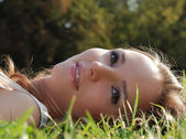 Beautiful young girl outdoors in summer — Stock Photo