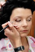 Making-up with eye shadow — Stock Photo