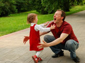 Laughing man (father) playing with littl — Stockfoto
