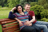 Young happy couple (pregnant woman) on b — Stock Photo