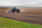 Ploughing tractor — Stock Photo