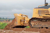 Small bulldozer blade in action — Stock Photo