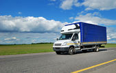 Delivery minitruck with white cabin and — Stock Photo