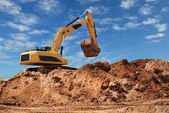 Excavator bulldozer in sandpit — Stock Photo