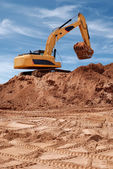 Excavator bulldozer in sandpit — Stock Photo