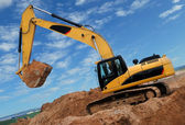 Excavator in sandpit — Stock Photo