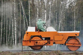 Orange road roller — Stock Photo