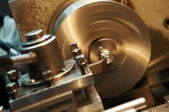 Facing metal blank by cutter on lathe — Stock Photo