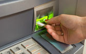 Inserting plastic card visa into ATM — Stock Photo