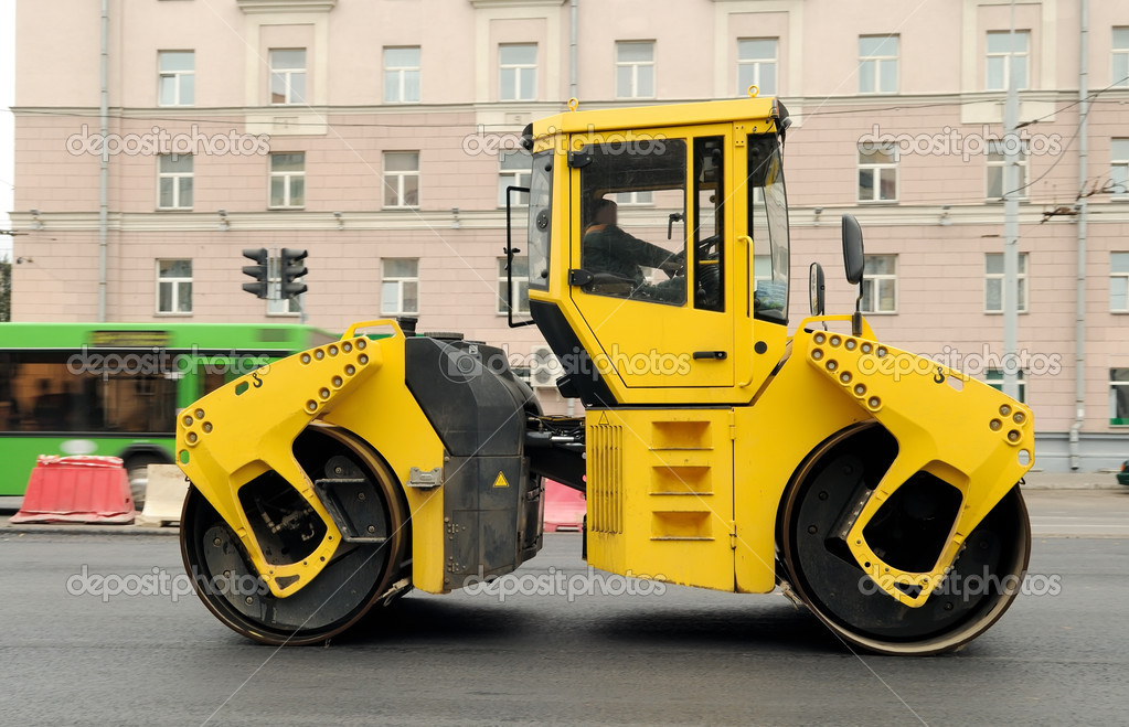 Heavy yellow roller compactor asphalting the town road  Stock Photo #1051016