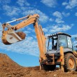 Excavator Loader with rised backhoe - Stock Photo