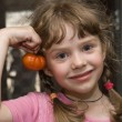 Girl with tomato — Stock Photo #1128988