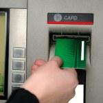 Inserting plastic card visa into ATM — Stock Photo