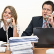 Happy operators speaking by phone — Stock Photo