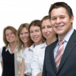 Happy business team in line — Stock Photo