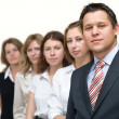 Serious business team in line — Stockfoto