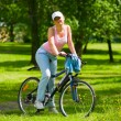 Royalty-Free Stock Photo: Woman rests on the bike