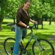 Woman bicyclist on the bike — Stock Photo