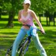 Royalty-Free Stock Photo: Woman get ride on the bike