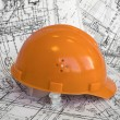 Royalty-Free Stock Photo: Orange helmet and project drawings