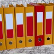 Yellow binder folders in the design draw — Stock Photo #1033232