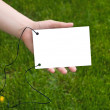 Hands holding a paper note — Stock Photo #1035334