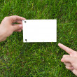 Hands holding a paper note — Stock Photo #1035335