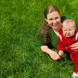 Royalty-Free Stock Photo: Mother and child on grass