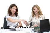 Two young women shaking hands — Stock Photo