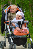 Two babies in children buggy — Stock Photo