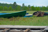 Boats in green grass — Stock Photo