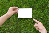 Hands holding a paper note — Stock Photo